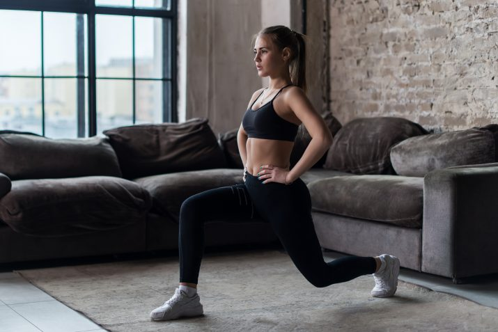 Woman doing lunges at home