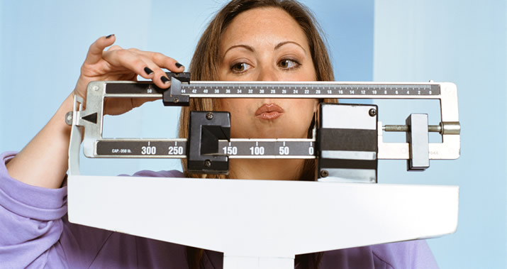 Frustrated woman on the scale